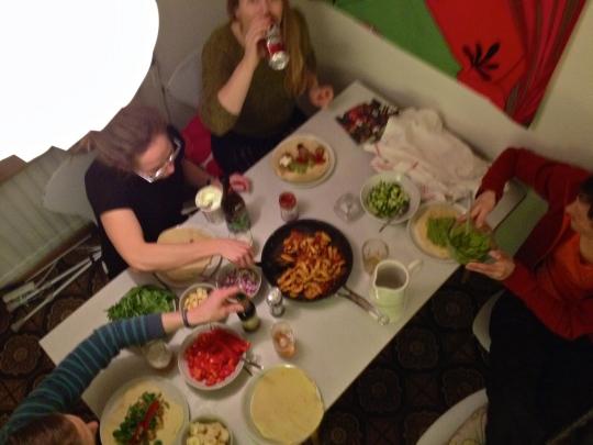 Good friends making us dinner