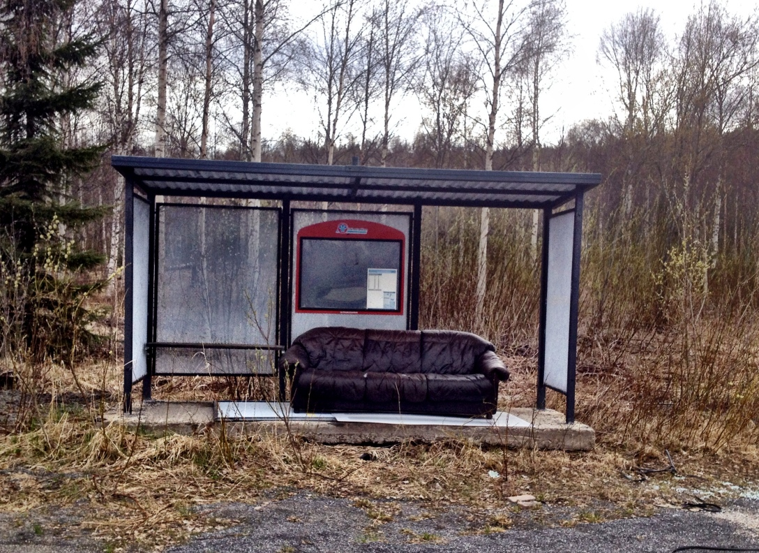 A bus stop with a leather sofa