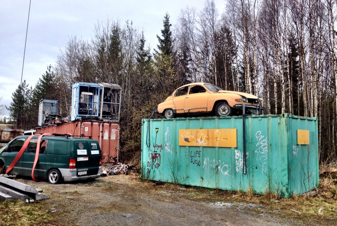 An old Saab on a shed, and a van waiting to get up on its own shed