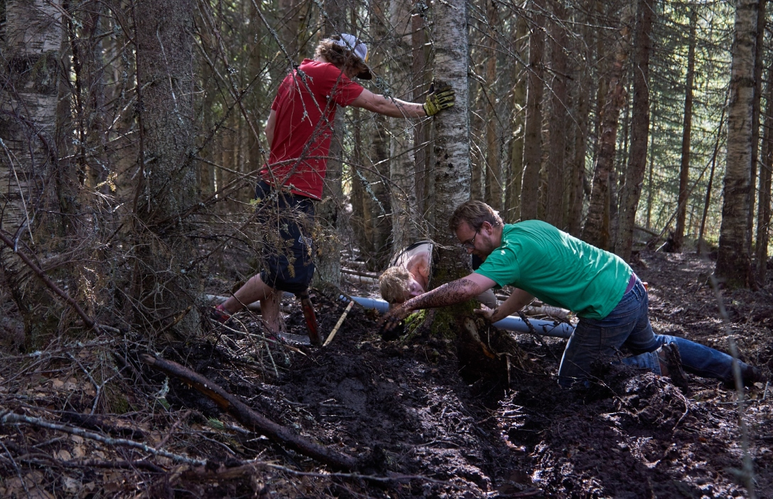 Martin, Jonas and Matt digging ditches in a bog