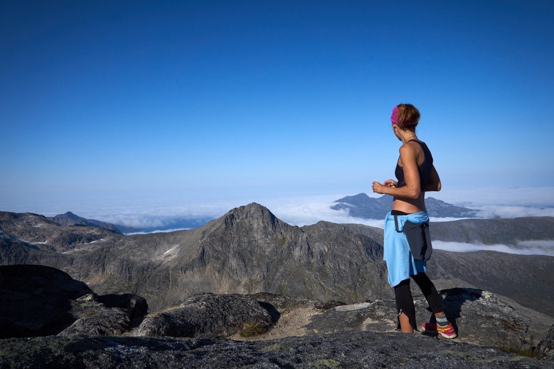 Lina at the summit of Store Blåman. Vengsøy in the background.