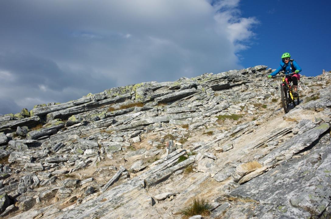 Me going down a sandy rock slab. Photo by Martin.