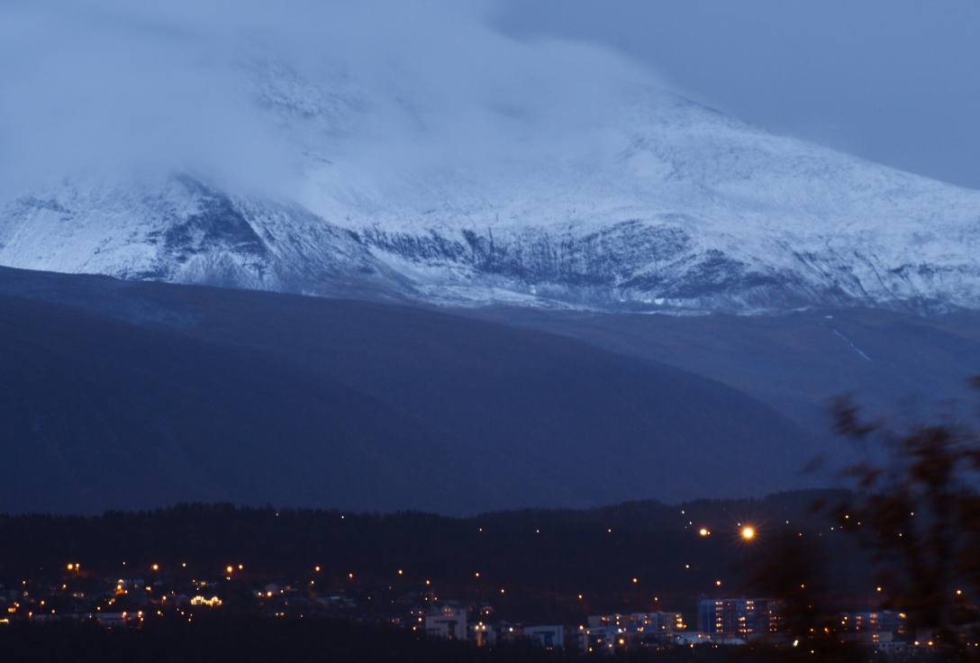 A giant dressed in winter watching over Tromsø.