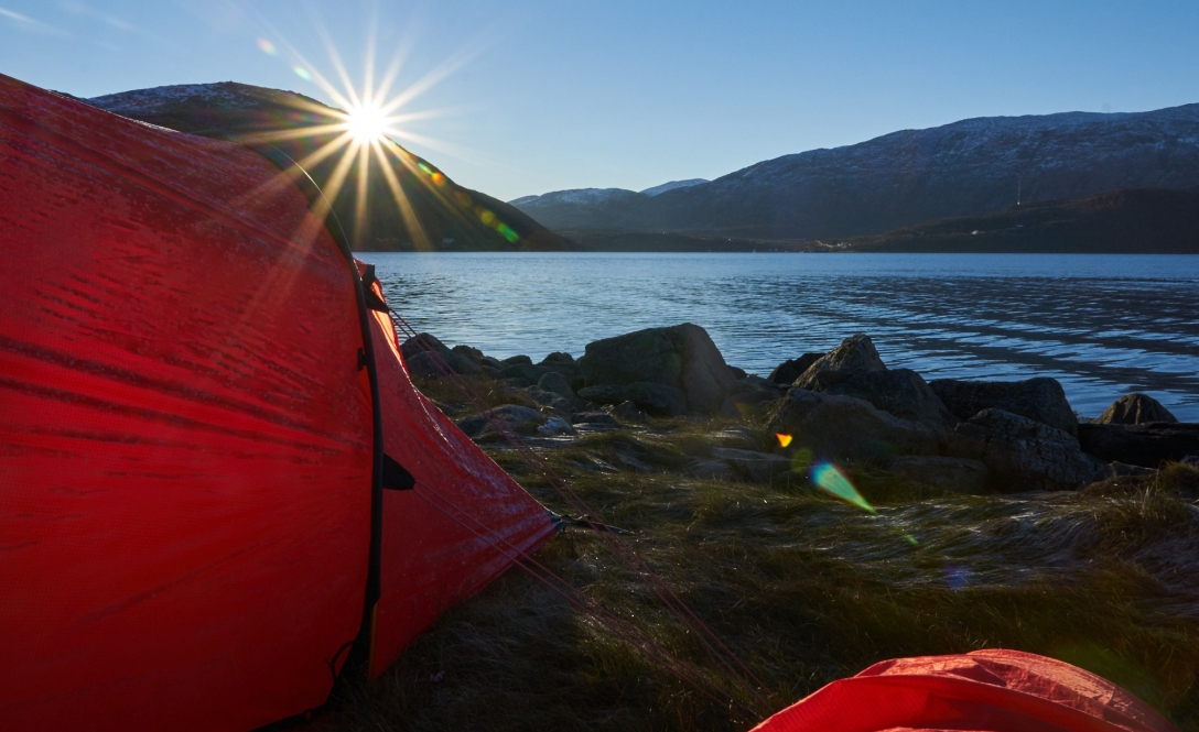 Sun over Skulsfjord and a tent that had to endure the night empty.