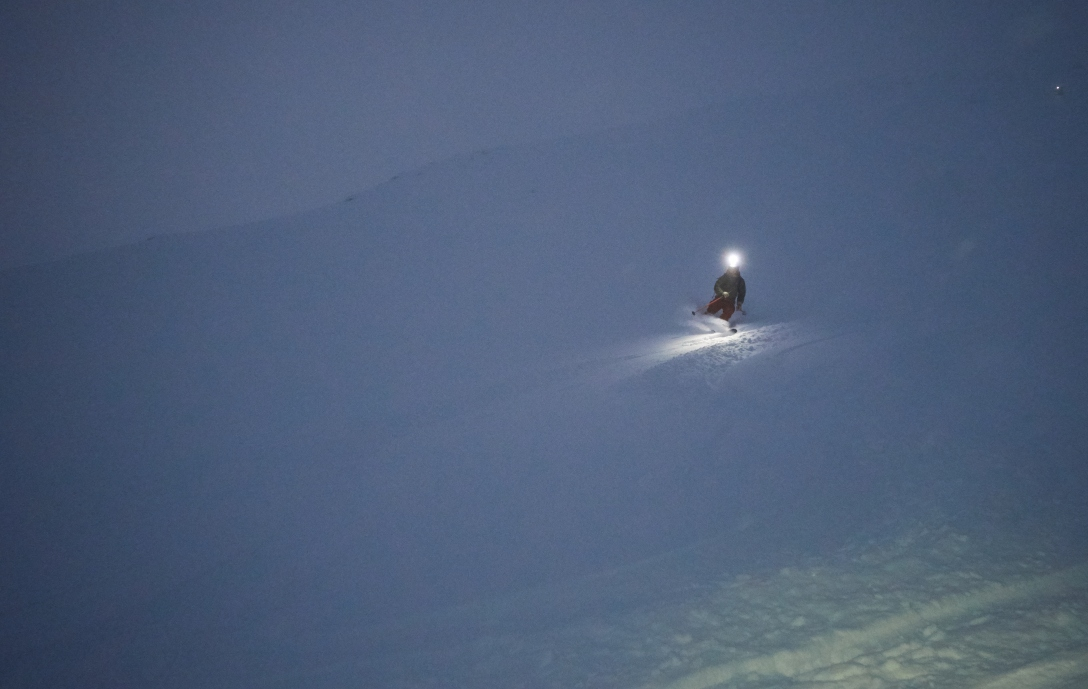 Unknowns skier shredding pow on Skitntind.