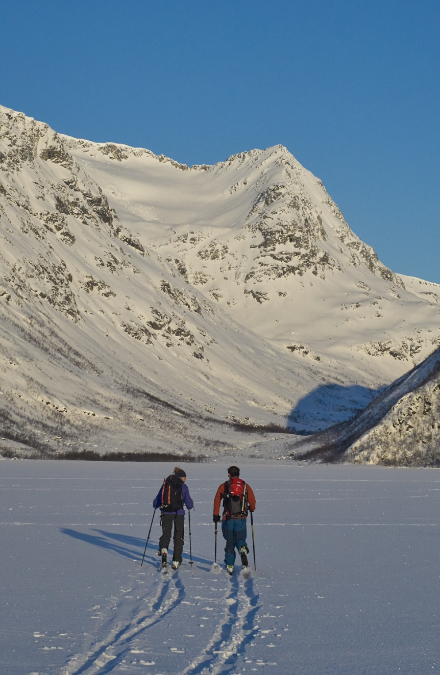 Jon HP and Emma crossing the lake on the approach to Istinden.