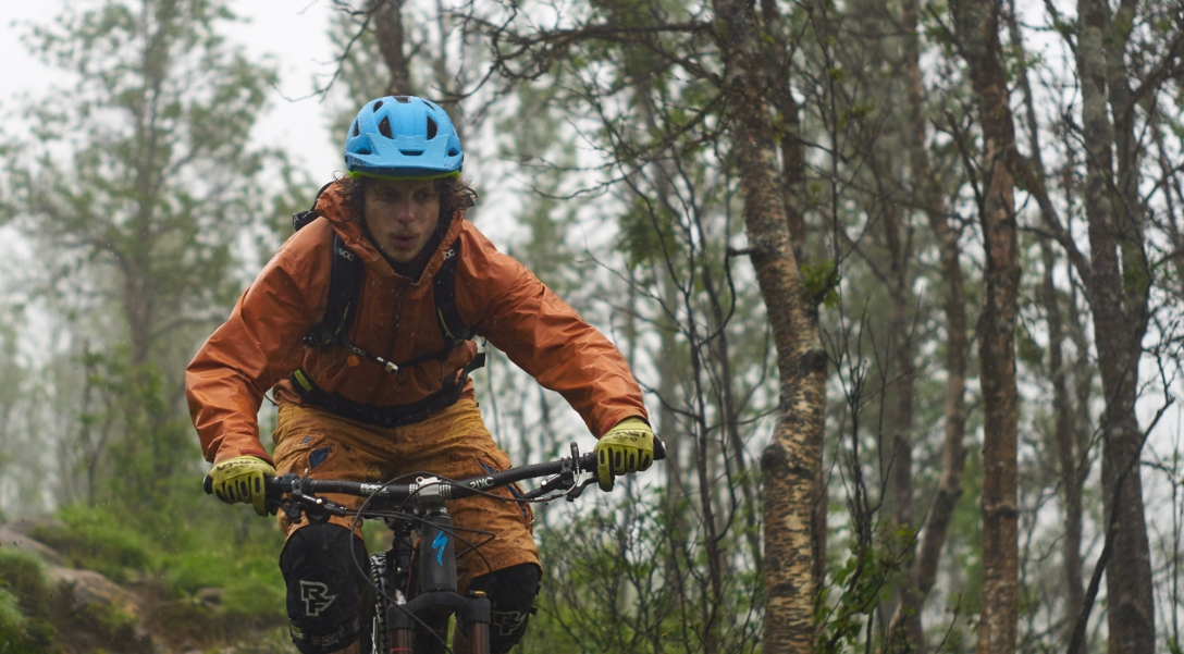 Martin getting soaked while riding his bike in Tromsdalen.