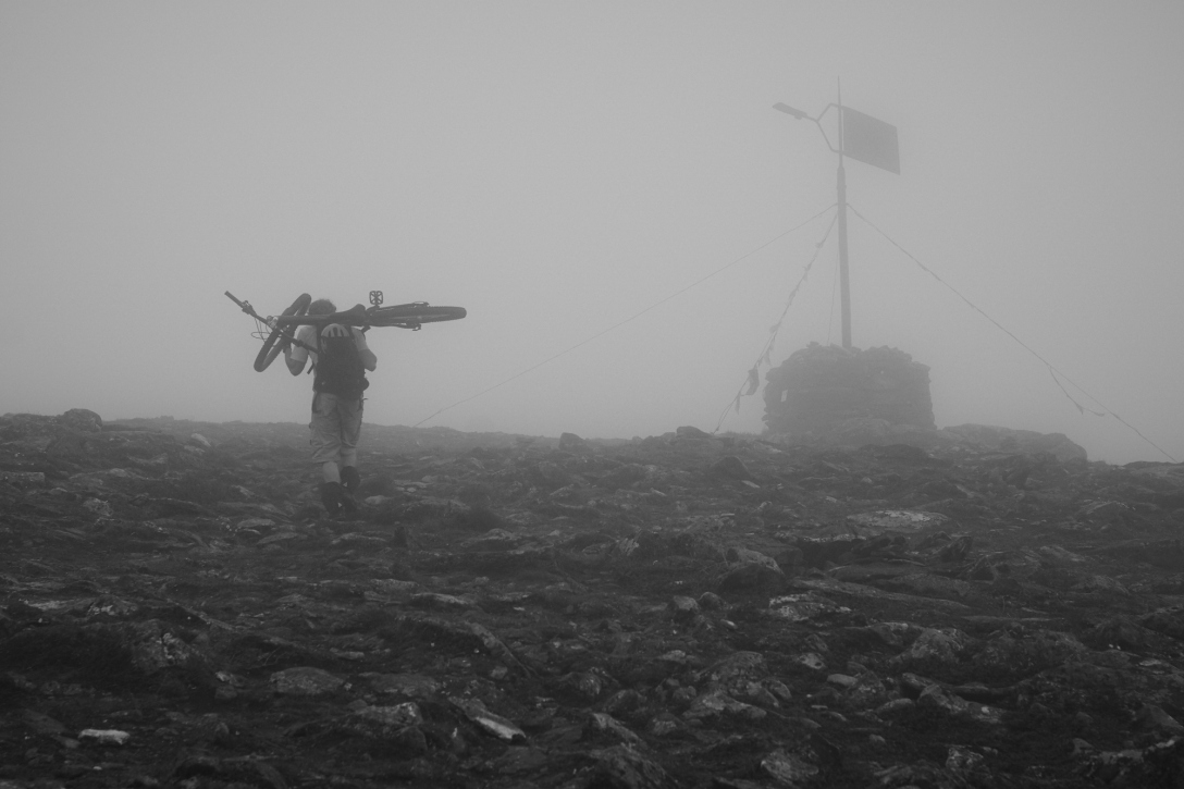 Martin approaching Fløya, the mountain behind our house. In fog and rain of course.