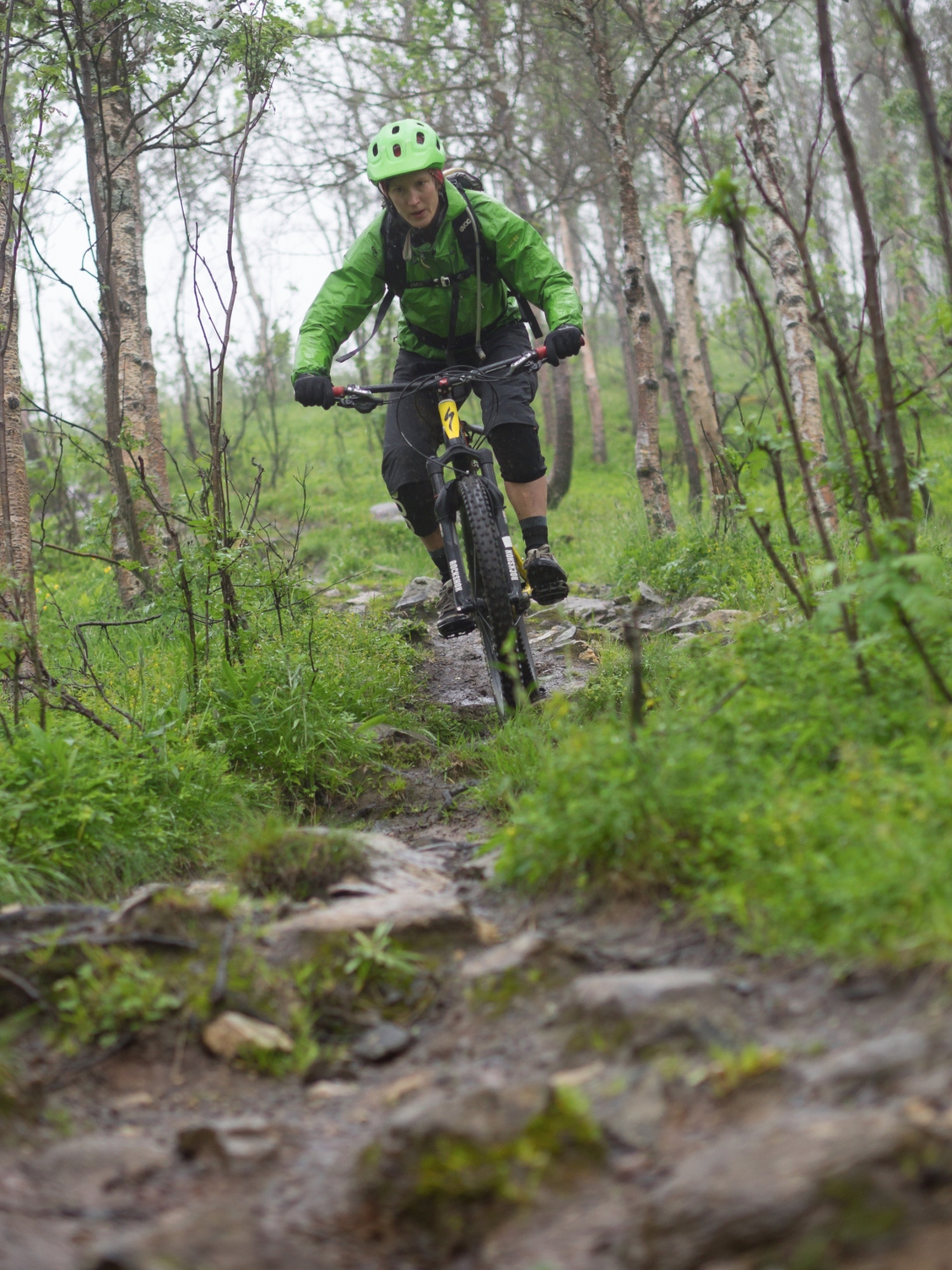 Sliding down some rocks and mud in Tromsdalen. Photo by Martin.